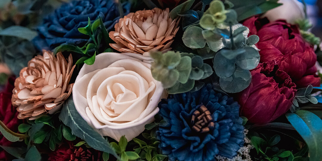 Close up detail shot of a burgundy, navy, and ivory bouquet by Heart and Sola Creations